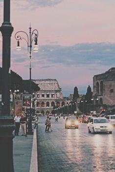 Roma at sunset by the Colosseum