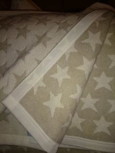 Gorgeous taupe and cream star throw / blanket its just fab!!  Bought for my new arrivals nursery but I think I will keep another for the sofa at these prices!!!   Measures 150cm x 200cm Is machine washable at 30 degrees or dry clean...Also available in dark blue reversible pale blue now in stock