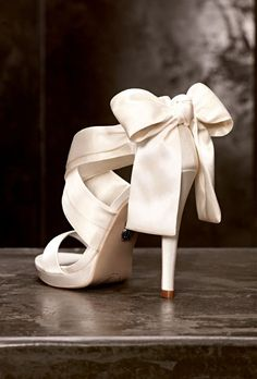 Advice for choosing the best wedding shoes to compliment your wedding dress and personal style by Brides  These are White by Vera Wang satin bridal shoes with a bow.  with <3 from JDzigner www.jdzigner.com