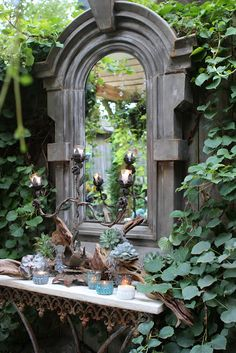 mirror and French pastry table in the garden