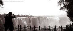 The waterfalls of Victoria Falls in Zimbabwe. Featured in the list of top ten places to visit in Zimbabwe, Africa. By Beth from Great Zimbabwe Guide, an independent travel blog.