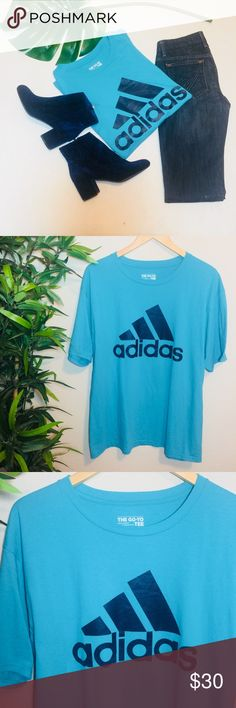 "Adidas unisex logo my go to tee Super cool unisex Adidas ""my go to tee"" with huge signature logo across the chest. The graphic is a dark blue on a aqua blue shirt. In perfect condition would look awesome cropped/tied/ or worn normal. 60% polyester 40% cotton adidas Shirts Tees - Short Sleeve"