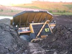 For reference. This particular vehicle is a mine haul truck with a carrying capacity of 380MT. It is HUGE!...and very stuck