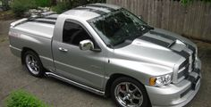 """It's a limited edition 2005 Dodge Ram 1500 SRT-10 Viper..yes same Viper motor as in the famous coupes and no it's not a Hemi but a V-10, which is a 505 c.i. monster or for you metric guys a 8.3L. It's the standard cab with the Hurst six-speed on the floor, disc brakes that could stop a semi, leather with suede, Infinity sound system, tinted windows, 22"""" wheels mounted on 305's 40R/22's, chrome side pipes, tonneau cover w/spoiler, alarm w/ lowjack and just under five thousand built for '05."""