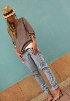 boyfriend jeans. slouchy sweater/layers. heels. hat.
