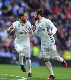 Sergio Ramos of Real Madrid celebrates with Nacho after scoring his team's 1st goal during the La Liga match between Real Madrid CF and Malaga CF at the Bernabeu on January 21, 2017 in Madrid, Spain.