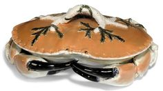 AN ENGLISH MAJOLICA TUREEN AND COVER IN THE FORM OF A CRAB CIRCA 1880, IMPRESSED DATE LOZENGE Naturalistically modelled and painted in shades of orange with black claws, the handle formed as a coral branch entwined with seaweed 13½ in. (34.3 cm.) wide | CIRCA 1880, IMPRESSED DATE LOZENGE | marine life and shells, sauce boats & tureens | Christie's