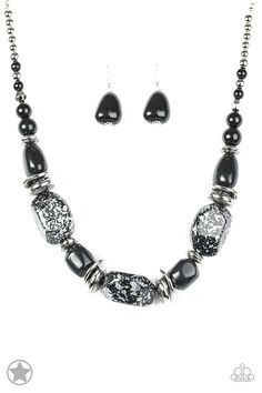 In Good Glazes - Black: Chunky black beads with speckles of silver and a gorgeous glazed finish are threaded together with thick silver rings and smooth black beads. Features an adjustable clasp closure.  Sold as one individual necklace. Includes one pair of matching earrings.