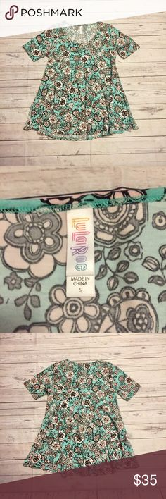 Black & teal floral print LulaRoe Perfect Tee Beautiful bright black teal and white floral print LulaRoe Perfect Tee in the soft slinky material. In excellent condition. Perfect comfy and casual staple addition to your casual wardrobe. Pair with Lula leggings or skinny jeans and Birks or Converse. LuLaRoe Tops Tees - Short Sleeve