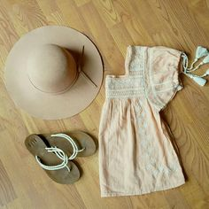 Forever 21 boho top Light peach top with embroidery and crochet details.. Square neckline in front and back. Pretty gathered sleeves with tassels on them. This top is flowy and fabric is light. Hat and sandals NOT FOR SALE. NWOT Forever 21 Tops Blouses