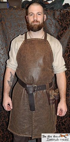 blacksmith apron Larp, Leather Working, Metal Working, Blacksmith Projects, Blacksmith Tools, Industrial Goth, Shop Apron, Leather Apron, Kids Dress Up