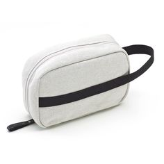 QWSTION - TOILETRY KIT - ORGANIC RAW DUOTONE - The Toiletry Kit is the perfect add-on for the road, the air or wherever else your travels may take you. This compact, functional piece of luggage comes in our signature-coated canvas, multiple storage pockets will keep your toiletries organised during your travels and the easy access hanger will allow you to have everything readily available wherever you end up.