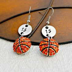 Basketball lovers everywhere, you can show your Love for your Favorite Player with these Beautiful Earrings. Hand stamped with your favorite Player's jersey number and a cute Basketball charm. These w