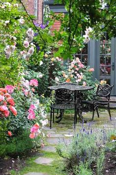Rose Garden cottage garden with roses, patio with patio dining set and fence covered in roses after reader remodel contest 2013 - On the way to swapping turf for cottage-style plantings, this self-taught gardener discovered a passion for her new pastime Cottage Garden Design, Diy Garden, Dream Garden, Backyard Cottage, Porch Garden, Fence Garden, Shade Garden, Herb Garden, Garden Projects