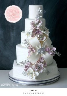 5 tiers of stunning artistry. The silver/metallic touches, the bow.. Lilac and white. Would be perfect for winter or spring!
