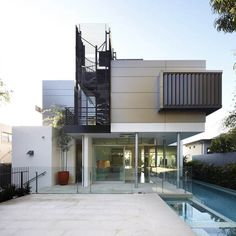 Image from http://meddiodesign.com/wp-content/uploads/2014/12/exterior-modern-house-design-ideas-with-minimalist-style-and-level-floors-also-spin-staircase-combine-with-iron-trellis-and-glass-windows-also-sliding-glass-door-and-glass-barriers-also-swimming-pool.jpg.