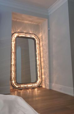 Get a fram and put it at the start of a hallway, and put mirrors on either side to make it look like a mirror : through the looking glass party idea
