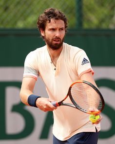 Ernests Gulbis Photos - Ernests Gulbis of Latvia serves during the mens singles first round match against Gilles Muller of Luxembourg during day two of the 2018 French Open at Roland Garros on May 2018 in Paris, France. - 2018 French Open - Day Two French Open, First Round, Luxembourg, Paris France, Two By Two, Day, Roland Garros