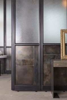 Detail of blackened steel patchwork and wire glass from the Frankford Panel System.  Fully modular, the Frankford Panel system is available in a range of sizes and finishes, and can used to create an array of flexible architecture. What will you build?