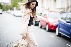 Anisa Sojka wearing beige Fashionnoiz wide-leg pant suit, black H&M cami top, Shashi stackable hippie bracelets and beige 3.1 Phillip Lim mini pashli cross-body bag. Fashion blogger streetstyle shot in London by Cristiana Malcica.