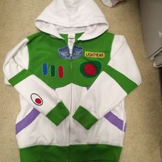 Buzz Lightyear hoodie Super cool Buzz Lightyear hoodie! Excellent condition, worn twice. Large in kids, but would fit a xsmall/small in adults. Purchased in Disney store (Florida mall.) Disney Store Tops Sweatshirts & Hoodies