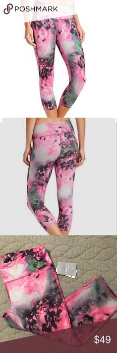 """NWT Athleta XL Bloom Chaturanga Pink Floral Pant NWT Athleta Bloom Chaturanga Capri, Mulitcolored abstract floral print: PINK/BLACK/GREEN/GRAY/PURPLE/BLUE , XL.  Crops / cropped.  Signature """"Pilayo"""" fabric, breathable, moisture wicking action!  Fitted allover style, great for running, yoga, gym training, pilates, zumba and more (and cute for running around town, too!).  Really pretty statement pants/tights/leggings/athletic wear/workout gear. Perfect condition. $64 new.  First 2 pics from…"""