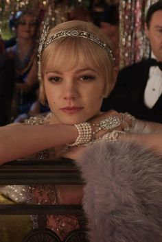 This shows that Daisy wishes she could find Gatsby. She attends all of his parties longing to see him.