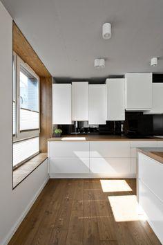 Mobilier scandinave en gris, blanc et bois dans un loft nordique super chic