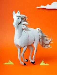 Paper sculpture of a running horse