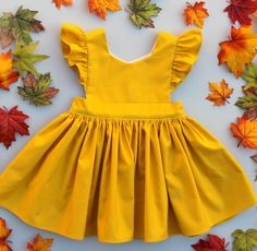 Cora Pinafore Dress in Mustard for baby toddler little girl long elbow sleeve co. - Cora Pinafore Dress in Mustard for baby toddler little girl long elbow sleeve cotton handmade button back warm cozy fall winter thanksgiving vintage inspired boutique Little Girl Fashion, Toddler Fashion, Toddler Outfits, Baby Outfits, Kids Fashion, Toddler Girls, Fashion Clothes, Toddler Dress, Kids Girls