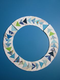 Flying Geese in a Circle - Paper pieced block; link to template in post.  Hm.  Make a Double Wedding Ring quilt with these?  (Stuff's not complicated enough, apparently. ~wry laugh @ self, & eyeroll~)