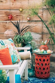 Home of Faith Blakeney. Shot by Dabito for The New Bohemians. Summer is almost here. Time get those patios ready for indoor outdoor living! Handmade Solid Copper Hanging Plant Pot Cohanga Hanging Chair Rattan Plant Stand Tufted Global Stripe Throw Pillow – Threshold™ Fringed Hermosa Outdoor Throw Pillow Shibori Ceramic Vase – Small Haws Solid …
