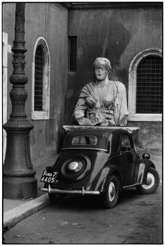 #Rome, 1955 - #1955 by ELLIOTT ERWITT  Born on July 26, 1928 in Paris, Elliott Erwitt spent his childhood in Milan. His interest in photography began while he was a teenager living in Hollywood. Elliott Erwitt was invited to join Magnum Photos in 1953 and has been a member of the prestigious agency ever since, serving several terms as its president.