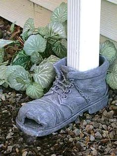 I thin I have an old shoe pot I could put a few holes in and use for this. so glad I kept it for the past 15 years! Decorative Downspouts, Potting Station, Copper Gutters, Drainage Solutions, How To Install Gutters, Bird Bath Garden, Old Shoes, Decorated Shoes, Water Features