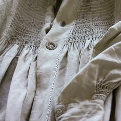 front of English smock showing heavy embroidery and sewing thread