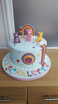Care bear and rainbow cake