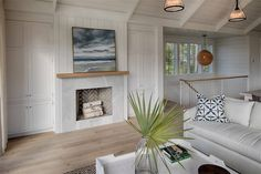 Fireplace in living room. Board and batten coastal cottage in Palmetto Bluff with modern farmhouse interior design by Lisa Furey. Modern Farmhouse Interiors, Cottage Interiors, Coastal Living Rooms, Coastal Cottage, Coastal Decor, Coastal Entryway, Coastal Rugs, Coastal Bedding, Coastal Farmhouse