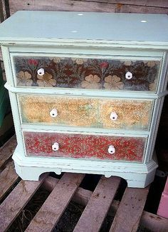 scrapbook paper decoupaged onto drawer fronts