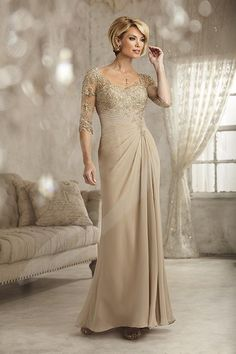 Balletts Bridal - 23395 - Mother of Bride by Jacquelin Bridals Canada - Embroidered lace forms the bodice, sheer high back, and ¾-length sleeves. The chiffon skirt has a pleated waist with front and back draping.