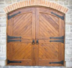 The end treatment on these hinges which resembles a spade (as in ace of spades) is referred to as a Norfolk design. These sturdy double Dutch doors feature Norfolk strap hinges and rope twist ring handles. Barn Style Doors, Barn Doors, Wooden Garage Doors, Underground Garage, Forging Metal, Hearth And Home, Stables, Blacksmithing, New Homes