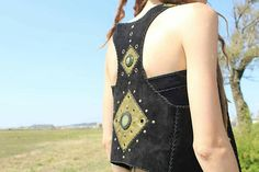 Check out this item in my Etsy shop https://www.etsy.com/pt/listing/521471260/handmade-leather-vest-with-two-green