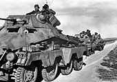 The Nazi propaganda picture shows soldiers of the German Wehrmacht on armoured reconnaissance vehicles in Tunisia. - pin by Paolo Marzioli