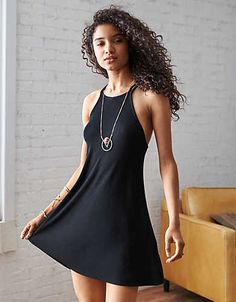 AEO STRAPPY HI-NECK SHIFT DRESS (online only) $39.95   This season's hottest hi-neck silhouette is equal parts bohemian retro & refreshingly right now. Not to mention, perfect for layering with your favorite bralettes.