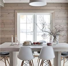 Small Dining Room with Wooden Wall and White Furniture