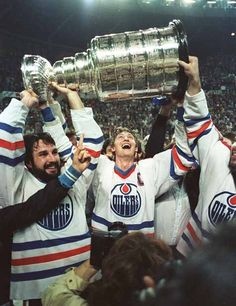 Wayne Gretzky and a bearded Paul Coffey hoist the Stanley Cup on May 19, 1984. It was the first Stanley Cup championship for the Edmonton Oilers. Photo by Mike Pinder, Edmonton Journal