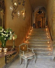 The candle lit staircase creates a very warm, romantic feeling in this natural room, really accenting the stone work.