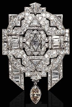 A COLOURED AND NEAR COLOURLESS DIAMOND BROOCH. The openwork pavé-set diamond plaque centring upon a navette-shaped diamond, enhanced by baguette and triangular-cut diamonds, suspending a detachable brown marquise diamond, mounted in platinum and 18K white gold, with French assay marks and maker's mark. In the Art Deco style.