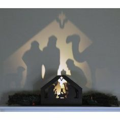 Nativity Shadow box from Sterling Pear. This beautiful piece allows you to display a lovely silhouette from the front while projecting an image from the back on the wall.