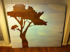 Paint around a stencil on a piece of wood flooring