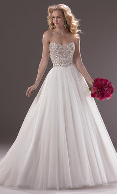 My dress!!! The Esme. Mine is ivory and silver (not the ivory and gold pictured) and will have less fullness in the skirt. So in love! <3
